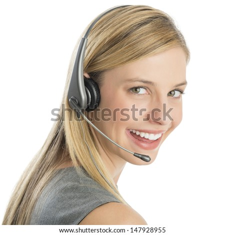 Close-up portrait of happy female customer service representative wearing headset isolated over white background - stock photo