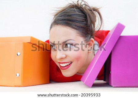Close-up portrait of happy girl with gift boxes