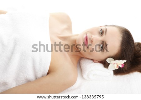 Close-up portrait of happy lady relaxing in a spa salon - stock photo