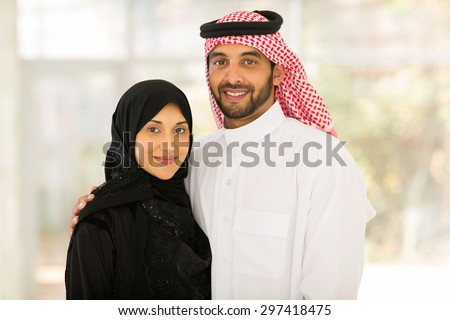 close up portrait of happy middle eastern couple at home - stock photo