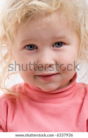 close-up portrait of happy smiling baby on white background