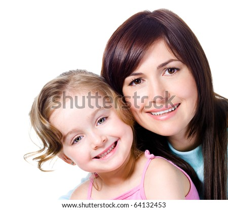 Close-up portrait of happy smiling faces of beautiful young mother with daughter - stock photo