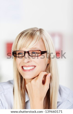 Close up portrait of happy woman while looking at something - stock photo