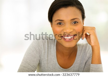 close up portrait of happy young african american woman - stock photo