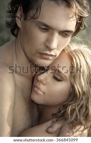 Close-up portrait of happy young couple in love - stock photo