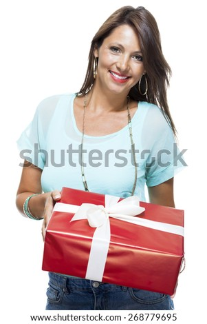 Close up Portrait of Happy Young Woman in Casual Clothing Holding a Red Big Gift Box with White Ribbon While Looking at the Camera. Isolated on White Background. - stock photo
