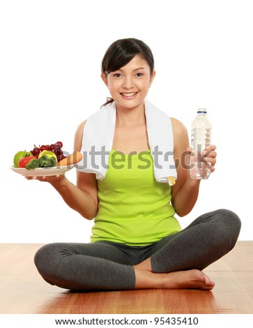 close up portrait of healthy fitness woman carrying a group of healthy food and water - stock photo