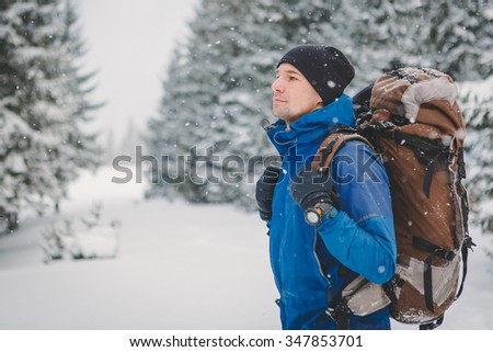 close up portrait of hiker in winter mountains  - stock photo