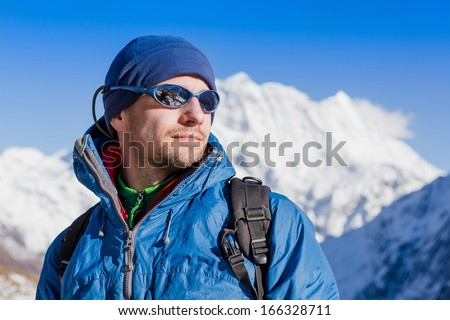 close up portrait of hiker looking at the horizon high in the mountains