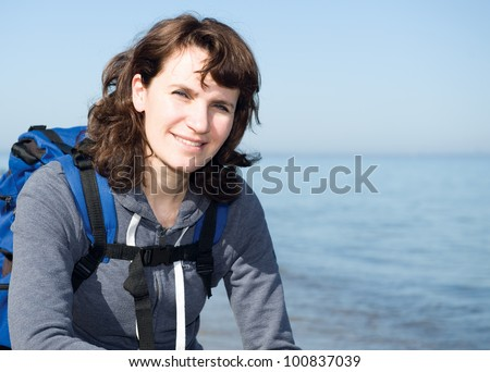 Close-Up portrait of hiking relaxing woman at sea - stock photo