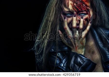 Close-up portrait of horrible zombie woman. Horror. Halloween - stock photo