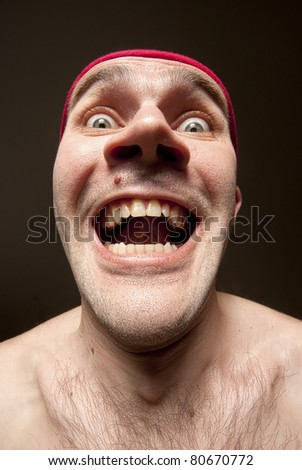 Close-up portrait of insane funny surprised man - stock photo