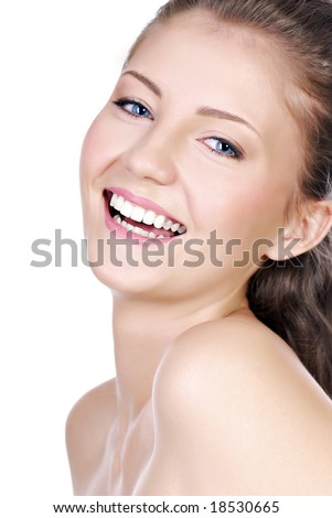 Close-up portrait of Laughing teenage girl  with the bright expressing positivity - stock photo