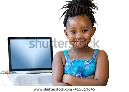 Close up portrait of little african kid standing with laptop in background.Isolated on white background. - stock photo