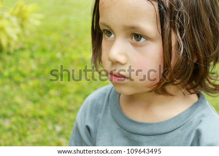 close up Portrait of little boy in summer day at the park - stock photo