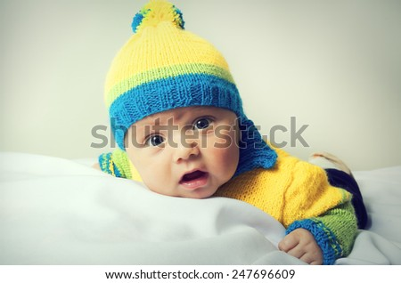 Close up portrait of little cute baby in a hat - stock photo