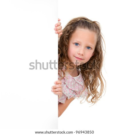Close up Portrait of little girl holding copy space. Isolated on white background.
