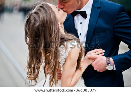 Close up portrait of loved wedding couple - stock photo