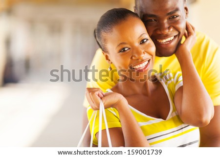 close up portrait of lovely african couple embracing - stock photo