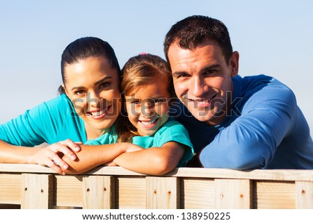 close up portrait of lovely family outdoors - stock photo