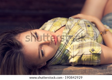 Close-up Portrait of Lying Beautiful Woman. Trendy Hipster Lifestyle Concept. - stock photo