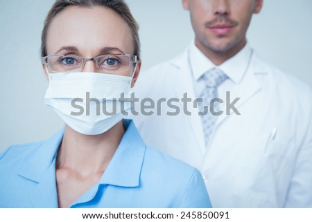 Close up portrait of male and female dentists - stock photo