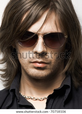 Close up portrait of man in sunglasses - stock photo