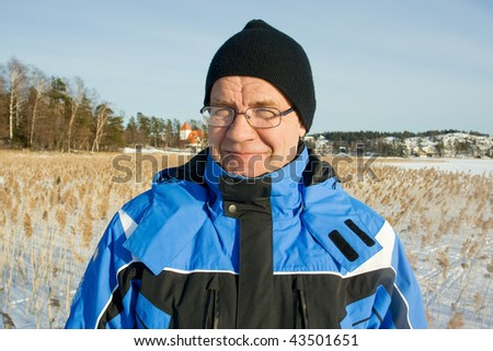 Close-up portrait of man outdoors in winter - stock photo