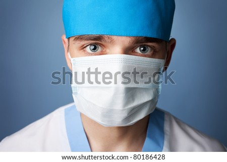 close up portrait of medical doctor in mask