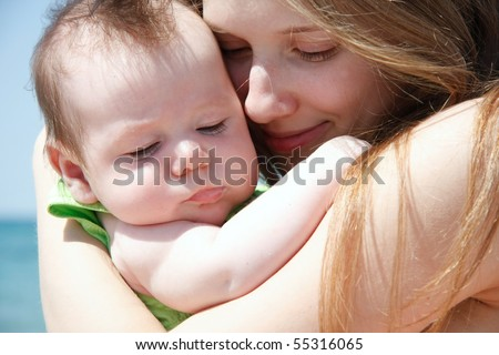 close up portrait of mother and baby on nature - stock photo
