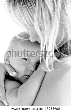 close up portrait of mother and baby over white - stock photo