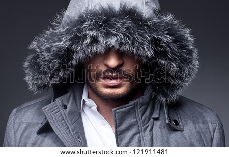 close up portrait of mysterious man on grey background - stock photo