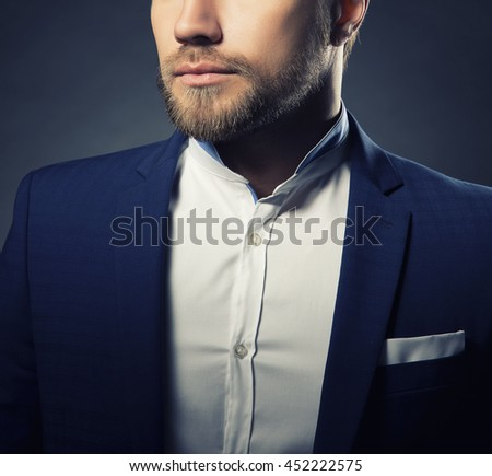 Close-up portrait of of handsome stylish caucasian young man in elegant blue suit with perfect hair style. Toned - stock photo