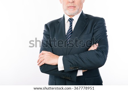 Close up portrait of old businessman with crossed hands