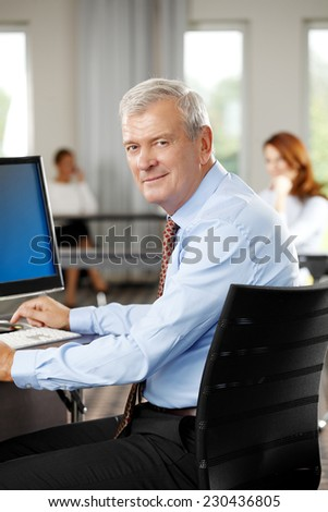 Close-up portrait of old businessman working at office.  - stock photo