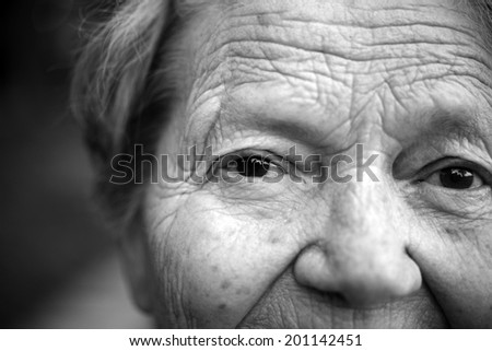 Close up portrait of older lady - stock photo