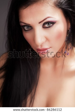 Close up portrait of one sexy young woman - stock photo