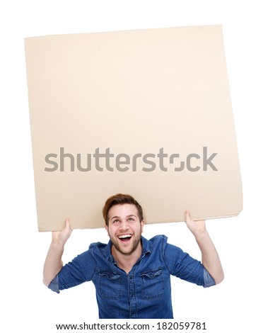 Close up portrait of one young man smiling and holding up blank poster sign on isolated white background - stock photo