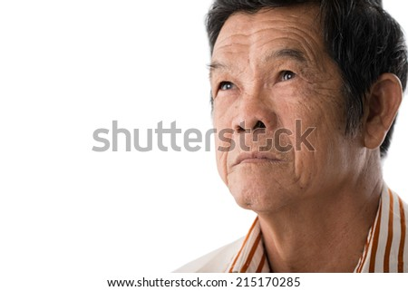 Close-up portrait of pensive senior man - stock photo