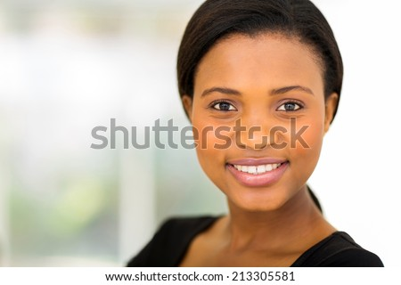 close up portrait of pretty african businesswoman - stock photo
