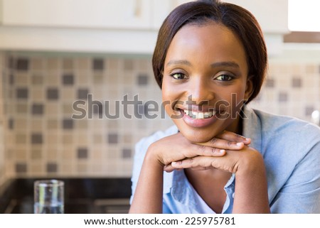 close up portrait of pretty african woman at home - stock photo