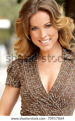 Close up portrait of pretty mature woman outside - focus on face - stock photo