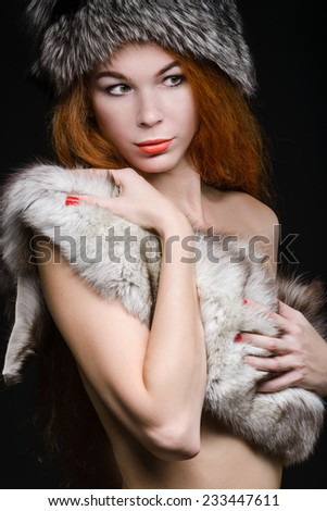 Close up portrait of pretty woman in furs - stock photo