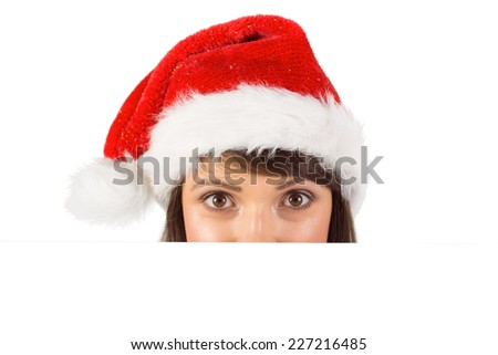 Close up portrait of pretty woman in santa hat over white background