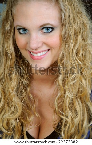 Close up portrait of pretty young blonde woman - stock photo
