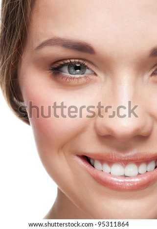 Close-up portrait of pretty young woman with beautiful make-up and perfect healthy skin - stock photo