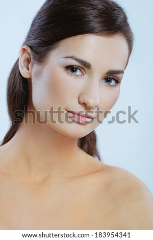 Close-up portrait of pretty young woman with perfect health skin - stock photo