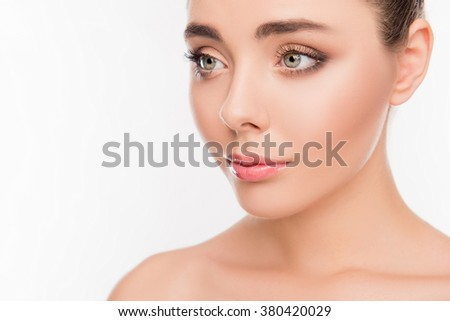 Close up portrait of pure sensitive girl isolated on white background - stock photo