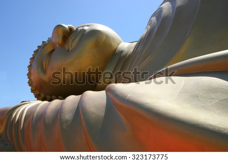 Close up portrait of reclining golden buddha at Wat Lampor,Songkhla Thailand - stock photo