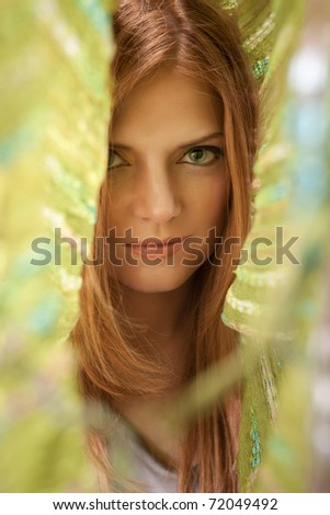 Close up portrait of red hair beautiful woman in green kerchief